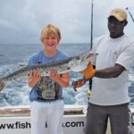 Happy Junior angler with Capt. Mike Pigott of Antigua NightWing Sport Fishing Charters