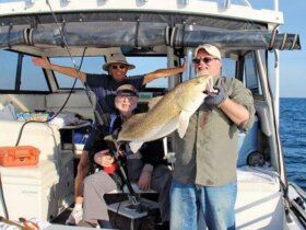 David Miller holding the rod that caught the fish, and his son Christopher holding his father's fish!