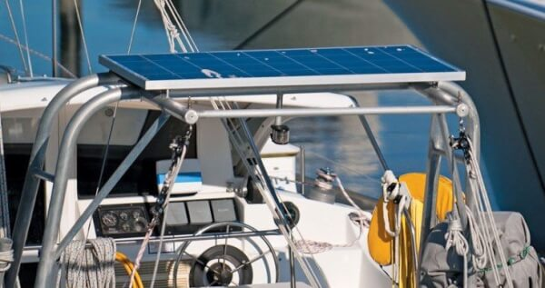 Dingy davits make an excellent location for solar panel installations. Photography By Glenn Hayes