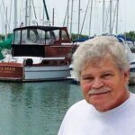 Ron Jung at the Key West marina where Back Again (in background) now resides. Photography By Glenn Hayes