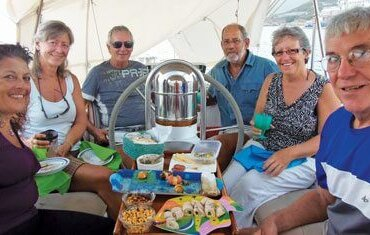 Cockpit party, (from left): Karel Dimitri, Tahani Li; Diana Hill, One White Tree; Phil Tenney, Tahani Li; Eric Toyer, Amarula; Lynn Dorning Sands, Amarula and 'EW' Hart from La Luna. Photo: www.HartatSea.com