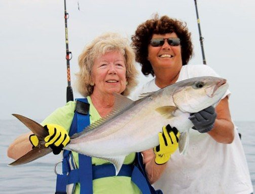 "It took a good 15 minutes of line stretching, but Jan Guidage landed her amberjack! Captain Brown said, ""The fish was a strong fighter, but Jan still managed it all by herself!"""