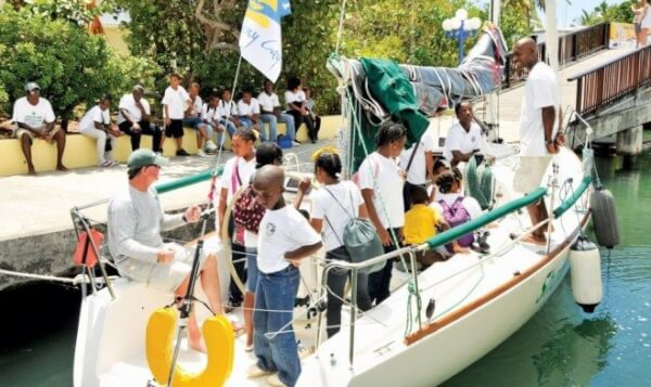 Crew of the J-95 Shamrock show youngsters the rigging of a racing boat at the BVI Spring Regatta