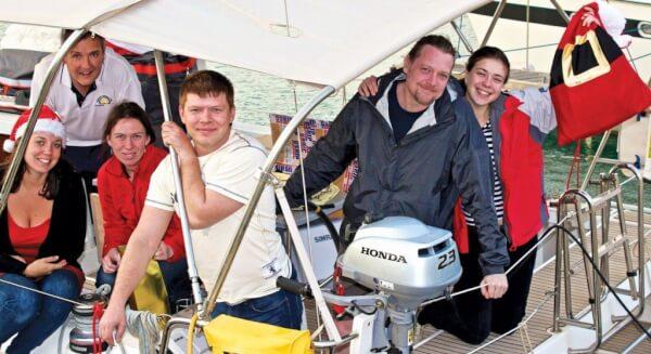 Family Affair – Nikolay Zakharevich and crew aboard Frizzanta, a Beneteau Oceanis 41. Photo by Louay Habib