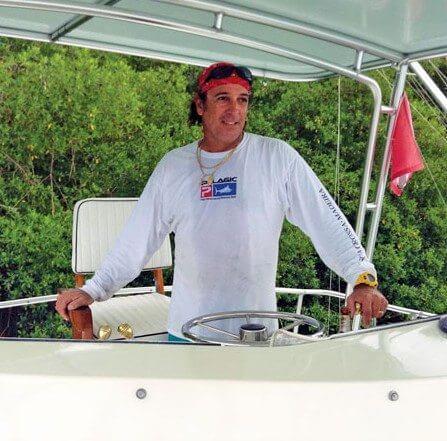 captain gerard frothy de silva aboard his Bertram 43