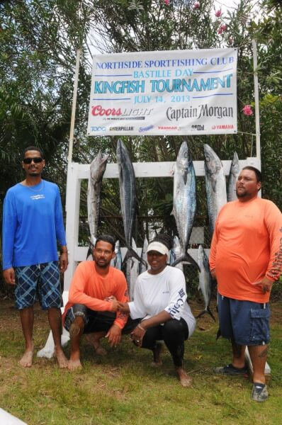 Photo: Mathew Laban, far left, wins the Largest Kingfish and Best Male prizes, while Tamika Turbe, second from right, wins Best Female award at the 25th Anniversary Bastille Day Kingfish Tournament. Credit: Dean Barnes
