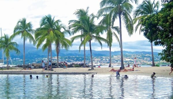 The beaches off Point du Bout are convenient to bistros and boutiques - and offer panoramic views of Fort de France, the capital. Photo by Mark Stevens