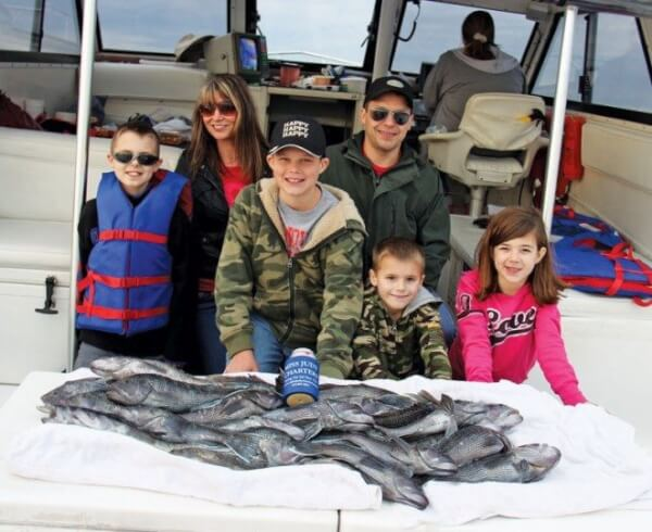 A fantastic fishing team! Front Row: Tanner Groholski, Sutton Kemp, Bennett Meinke, and Gracie Groholski. Back Row: Mitzi Groholski and Ian Meinke (All visiting from Greenville, WI).
