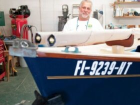 Jim Leet in front of a recently rejuvenated monohull at the Marine Concepts Sea Pearl shop. Photo by Glenn Hayes