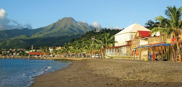 1. St. Pierre, Martinique: Impressive Mont Pelée volcano, a black sand beach and the historic waterfront comprise this number one view