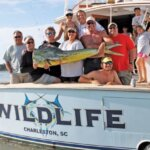 Team Wildlife back at the docks with a stud mahi mahi to display. By Jeff Dennis