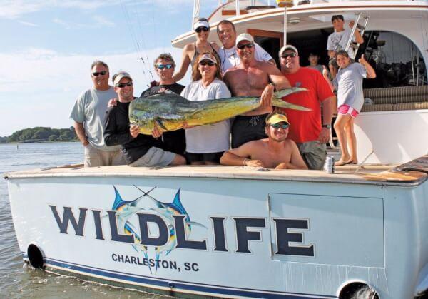 Team Wildlife back at the docks with a stud mahi mahi to display. By Jeff Dennis