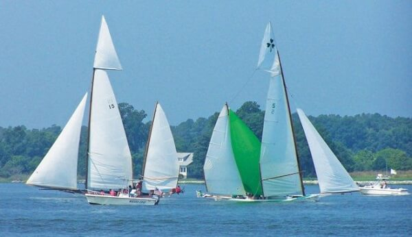 Majestic log canoe boats racing on the Eastern Shore of the Chesapeake Bay. Photo Credit: Mike Wright