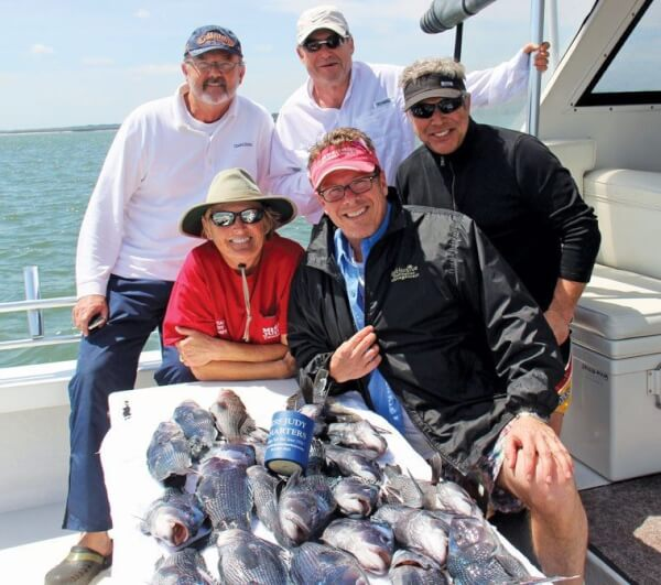 L-R Captain Judy and Josh Brown are front and center. Back row: Big John, Steve and Andy. Photo by Captain Judy Helmey