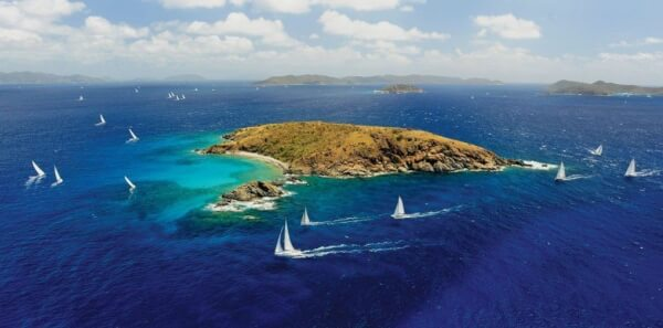 Boats round Flanagan Island during the last day of the BVI Spring Regatta. Photography by Todd VanSickle