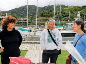 Carolyn confers with her fellow cruising wives about the latest acronyms