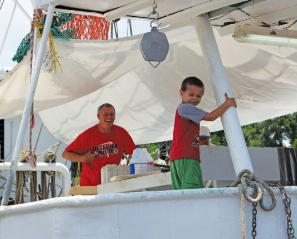 Shrimp and oyster fishing is handed down from generation to generation. Photo by Troy Gilbert