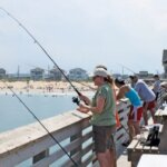 Anglers cast from Jennette's Pier looking to catch a fish. Photo by Jeff Dennis