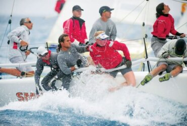 The winning Melges 32 team Smile and Wave—Meaghan Hislop hangs off the rail while heading downwind. Photography by Todd VanSickle