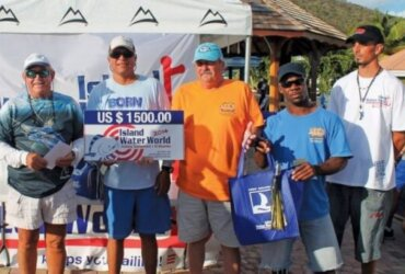 Lee Halley and crew celebrate at Bobby's Marina after winning the top two prizes at the Island Water World fishing tournament. Photo by Robert Luckock