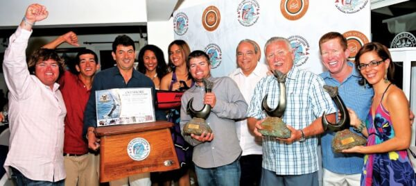 Frank Rodriguez (third right) owner of Fa La Me on the winner's podium. Photo: Richard Gibson