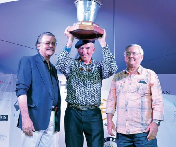 Raising the St. Barth Bucket (from left) Bruno Magras, president of the Collectivity of Saint Barth; Ed Bosarge, owner of the winning yacht Marie and Michel Magras, senator of Saint Barth. Photo: Rosemond Gréaux