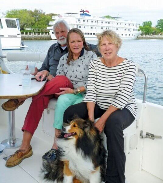 "Author Vicki with her dog Kota and friends Dennis and Vivian Lane on the ""back porch."" Photo credit: Barry Miller"