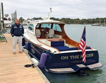 Captain Jamie Verlaque stands by the Hinckley Picnic boat named On The Rocks. Photos By Randolph J. Friedman