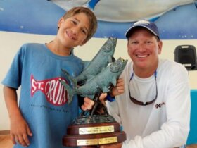 Capt. Juan and JC Jr. after Jr. won the 18th CYC Tarpon Tournament