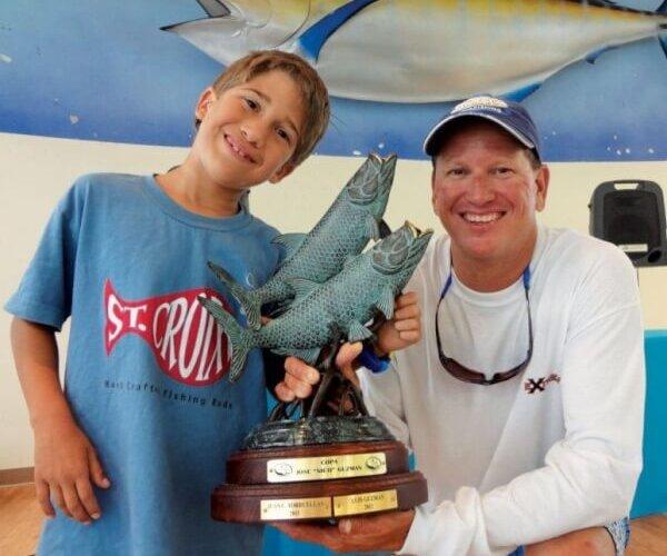 Capt. Juan and JC Jr. after Jr. won the 18th CYC Tarpon Tournament
