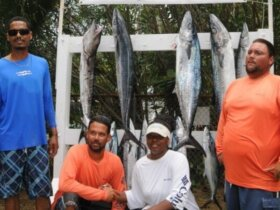 Photo: Mathew Laban, far left, wins the Largest Kingfish and Best Male prizes, while Tamika Turbe, second from right, wins Best Female award at the 2013 Anniversary Bastille Day Kingfish Tournament. Credit: Dean Barnes