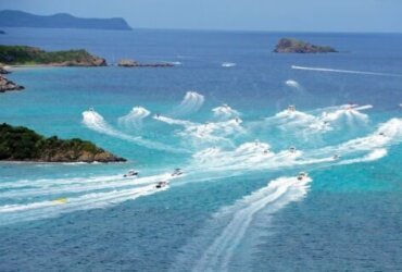 Boats cut between Virgin Gorda (left) and Mosquito Island for the start of the Leverick Bay Poker Run. Photo by Todd VanSickle