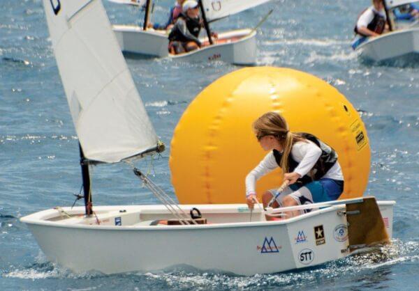 Mia Nicolosi racing an Optimist dinghy