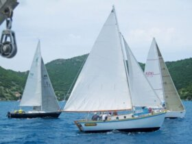 The Jost Van Dyke built sloop Endeavor II, with Foxy Callwood onboard, takes on the fleet. Photo courtesy of Geoff Brooks