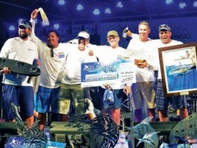 Oyster: Best Boat, Best Angler and Most Blue Marlin Releases – The winning crew with Captain Tim Roosens (second right) and Best Angler Jonathan Schaede (far right) take the stage in Marigot. Photo courtesy of the Saint Martin Sport Fishing Association