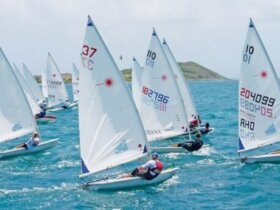 Start line action viewed from the committee boat. The Heineken Light Caribbean Open Laser Championships attracted a 24-­boat fleet of seasoned sailors and emerging youth Photo by Robert Luckock