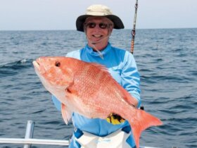 Terrell Gooding holding a nice genuine red snapper. Photo By Captain Judy Helmey