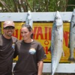 L to R: Capt. Christopher Sibilly and Melinda Bryan, who reeled in the Largest Kingfish, a 28.70-pounder. Credit: Dean Barnes