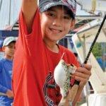 Kamryn Redlin catches a puffer fish