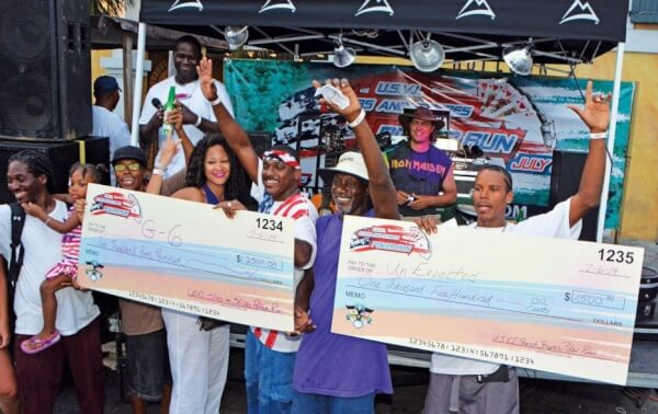 First Place Team G-6 (left) and second place Team Unexpected with their prizes at the downtown Charlotte Amalie block party and awards. Photo: Dean Barnes