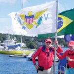 USVI Team Coach (left) and Jim Kerr with USVI flag