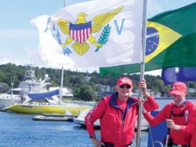 USVI Team Coach (left) and Jim Kerr with USVI flag