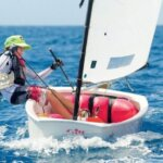 Rayne Duff sails to victor in the Back to School Regatta. Photo by Todd VanSickle