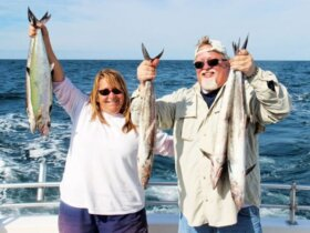 Captain Deidra Helmey Jeffcoat and Christopher Miller with a fistfull of king mackerel. Photo by Captain Judy Helmey