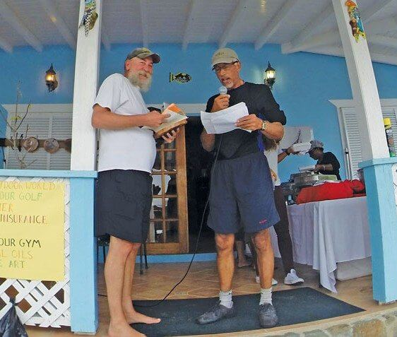 Champion Male Angler Glen Irish (left) receives his winnings from Dr. Kelvin Charles. Photo: Kimberley Hall