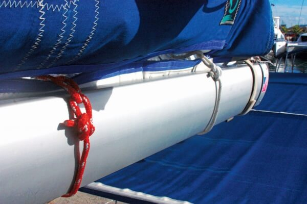 The tails on these bowlines on the boom end reefing lines are too short. Photo by Julian Putley