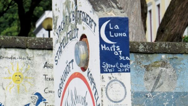 Following tradition, Barbara and EW added La Luna's name to Horta's famous wall. Photo by Barbara Hart