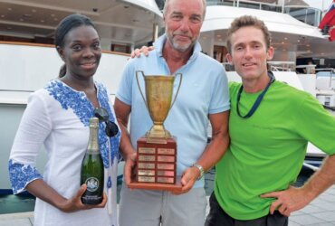 The owner of WinWin, (center) and his wife share the podium with skipper Clive Walker during the awards ceremony. Photo by Rosemond Gréaux