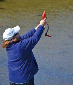Sue LaPalme demonstrates flare gun. Photo by Helen Aitken