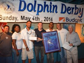 2014 Dolphin Derby Best Boat, Emanuel. L to R: Gerald Greaux, Jr., Tamika Turbe, Capt. Alvin Turbe, Kevin Lambert from Budget Car & Truck Rental, Gilbert Laban, John Clarke, and tournament co-director, Dr. Craig Friedenberg. Credit: Dean Barnes